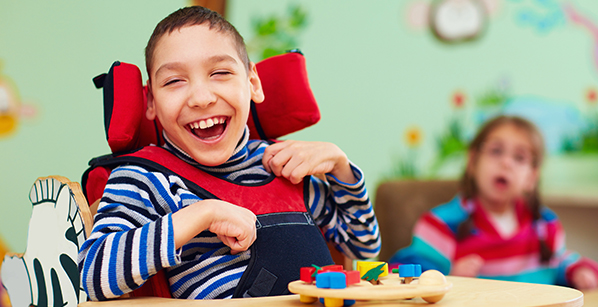 Smiling boy with disability