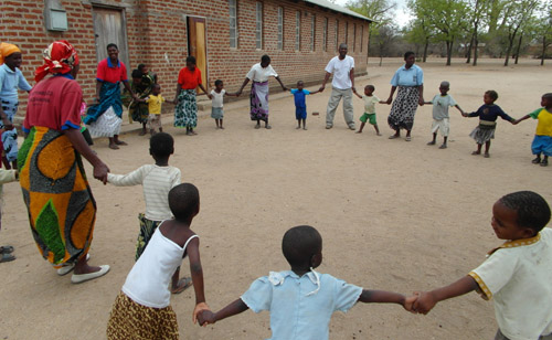 Children playing outside school in Malawi