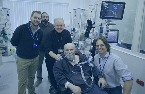 Professor Bob Stone (centre) with Intensive Care recovery patient, Nick Richards , and staff from Torbay and South Devon NHS Foundation Trust