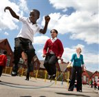 Children skipping in the playground