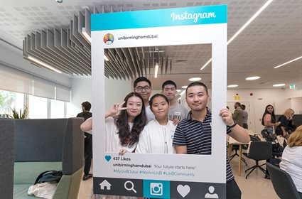 Students posing with selfie frame