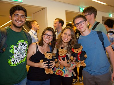 Students at the BISS awards ceremony with their graduate teddy bears