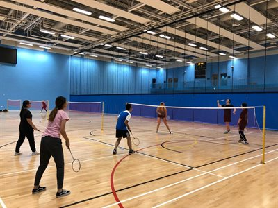 Students playing badminton at the UoB Sport and Fitness Centre