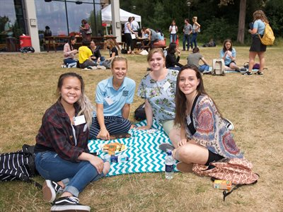 Students eating a picnic at welcome BBQ