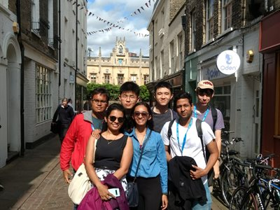 Students exploring cobbled streets in Cambridge