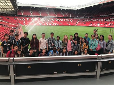 Students visiting the Old Trafford Football Stadium in Manchester