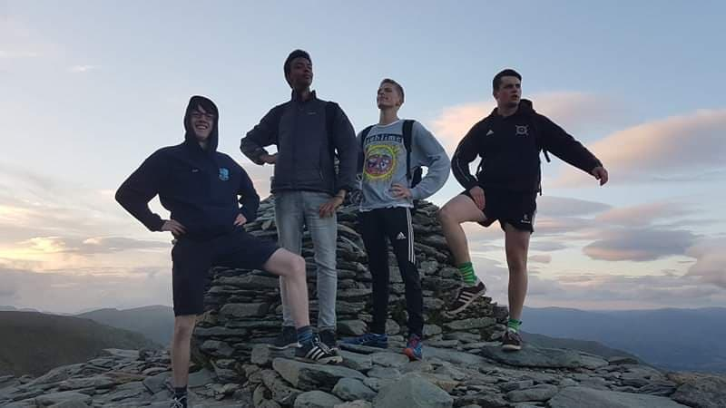 Students posing after a long climb