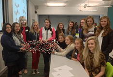 Group of female students attending a School of Chemistry STEM day event