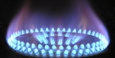 Close-up of gas hob ring flame