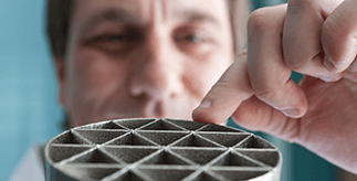Close-up of male manufacturing researcher at work