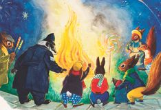 Tufty the squirrel and his animal friends by  a bonfire