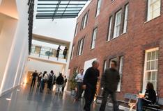 People walking through the Atrium in Birmingham Business School