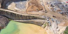 Aerial photo of industrial extraction activity by a coastlne