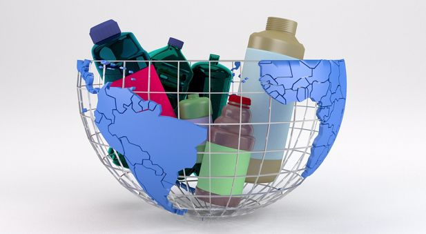 Various coloured plastic bottles in a globe-shaped basket.