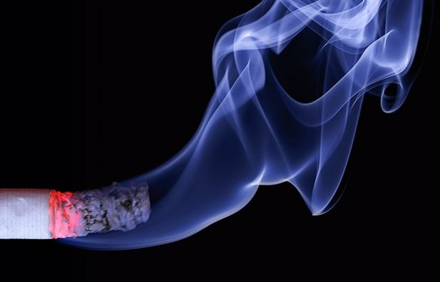 Photograph of smoke coming out of a cigarette.