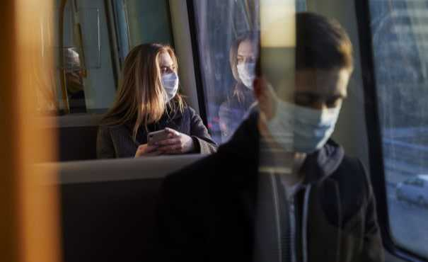 Woman and man on bus wearing face masks
