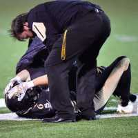 American football player with head injury