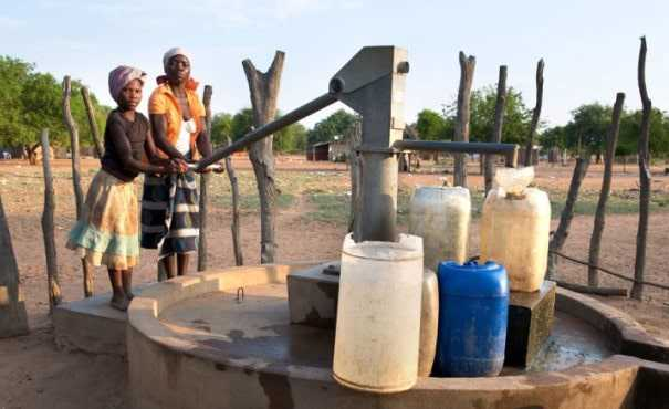 Children in Africa using water well