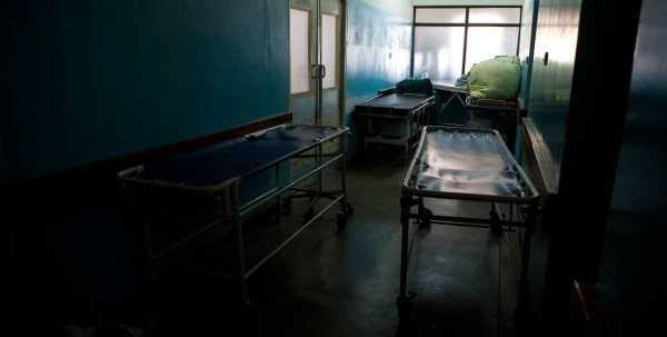 Hospital beds in dark corridor