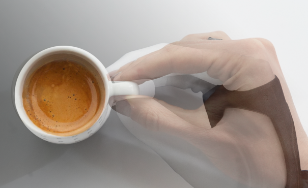 Human hand superimposed on a robot hand grasping a coffee cup