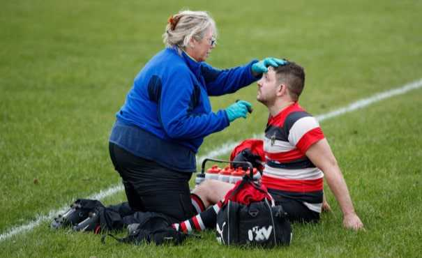 Injured rugby player with medic