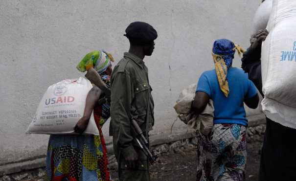 Soldier overlooking aid distribution