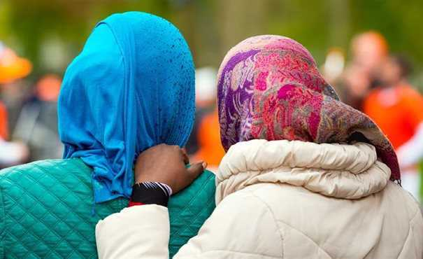 The back of heads of two Muslim women wearing head scarves