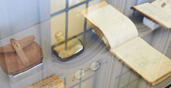 Objects relating to Oliver Lodge in a museum display case
