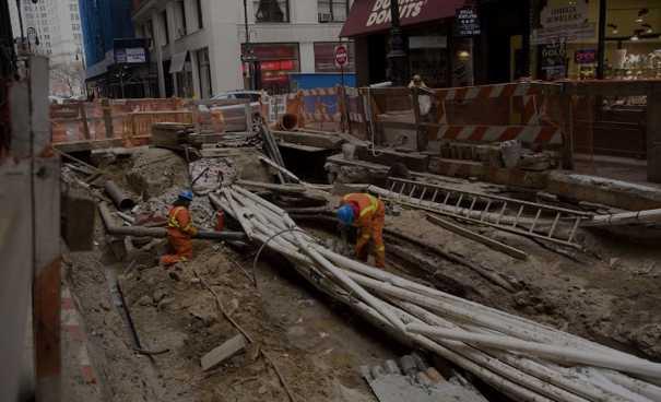 Workmen working on underground infrastructure