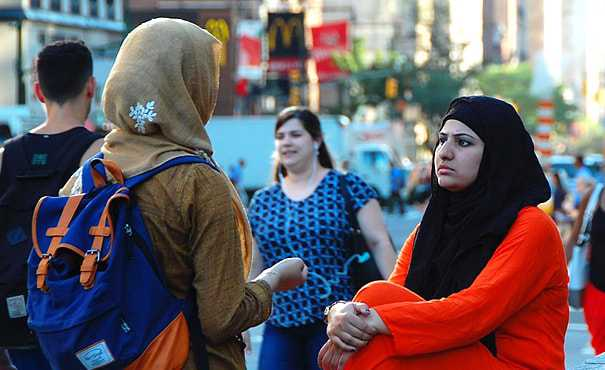 Two young Muslim women chatting in the street