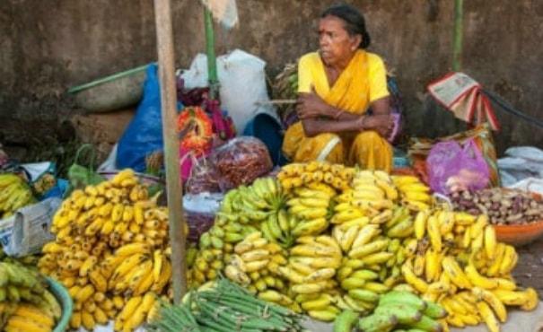 Woman selling bananas at a market