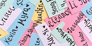 Colourful name labels in a pile