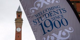 Welcome banner in front of clock tower